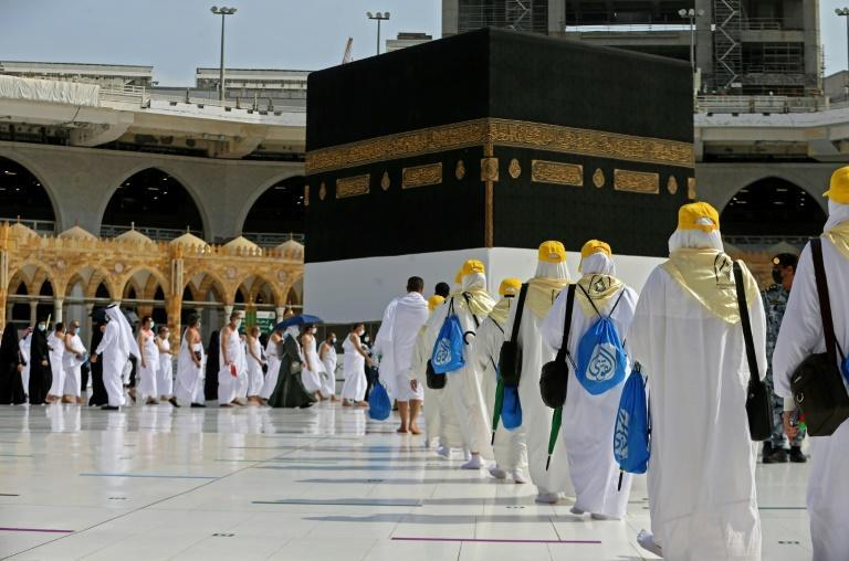 Pilgrims arrive at the Kaaba, Islam's holiest shrine, in the holy city of Mecca, at the start of the hajj on July 17, 2021