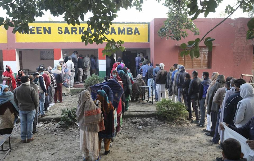 Jammu: Voters wait in queues to cast their votes during the second phase of the District Development Council(DDC) elections at Meen Sarkar Sambha in Jammu