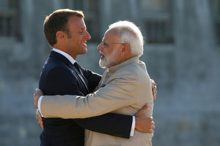 """French President Emmanuel Macron (L, pictured August 2019) held talks with Indian Prime Minister Narendra Modi, where the two vowed to work together to promote stability in the Indo-Pacific area in a way that precludes """"any form of hegemony"""" (AFP/PASCAL ROSSIGNOL)"""