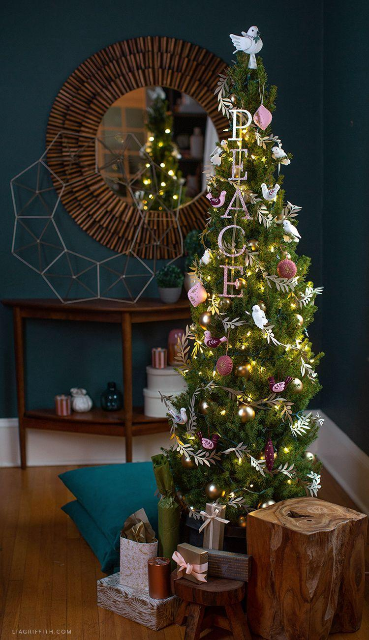"""<p>This tree is perfect for the family who feels Jesus is the reason for the season. The doves and references of peace are straight out of the Bible and make for one beautifully simple tree. </p><p><strong><em>Get the tutorial at <a href=""""https://go.redirectingat.com?id=74968X1596630&url=https%3A%2F%2Fliagriffith.com%2Fpeace-dove-christmas-tree%2F&sref=https%3A%2F%2Fwww.womansday.com%2Fhome%2Fhow-to%2Fg2025%2Fchristmas-tree-decorations%2F"""" rel=""""nofollow noopener"""" target=""""_blank"""" data-ylk=""""slk:Lia Griffith"""" class=""""link rapid-noclick-resp"""">Lia Griffith</a>.</em></strong></p><p><a class=""""link rapid-noclick-resp"""" href=""""https://go.redirectingat.com?id=74968X1596630&url=https%3A%2F%2Fwww.michaels.com%2F12x12-glitter-paper-recollections%2FM10142588.html&sref=https%3A%2F%2Fwww.womansday.com%2Fhome%2Fhow-to%2Fg2025%2Fchristmas-tree-decorations%2F"""" rel=""""nofollow noopener"""" target=""""_blank"""" data-ylk=""""slk:BUY GLITTER CARDSTOCK"""">BUY GLITTER CARDSTOCK</a></p>"""
