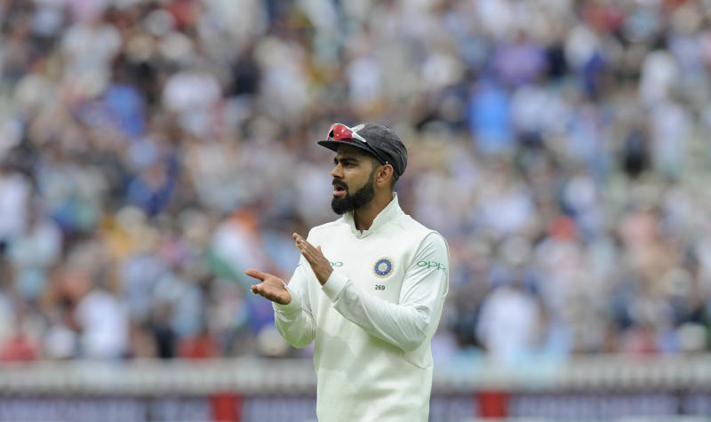 Indian cricket captain Virat Kohli applauds as he leaves the field at the end of an innings during the third day of the first test cricket match between England and India at Edgbaston in Birmingham England Friday Aug. 3 2018