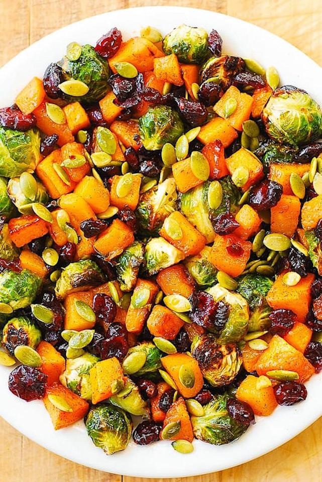 "Pumpkin seeds add hearty bite to this veggie-packed side.  <a href=""https://juliasalbum.com/maple-butternut-squash-roasted-brussels-sprouts-pumpkin-seeds-and-cranberries/"" target=""_blank"">Get the recipe here</a>."