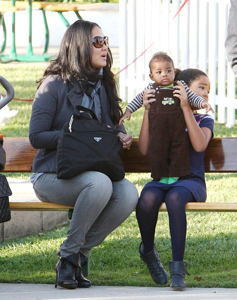 """Instead of hitting up the shops, Kimora and her brood hit up the playground. Mike/<a href=""""http://www.splashnewsonline.com/"""" target=""""new"""">Splash News</a> - November 22, 2009"""