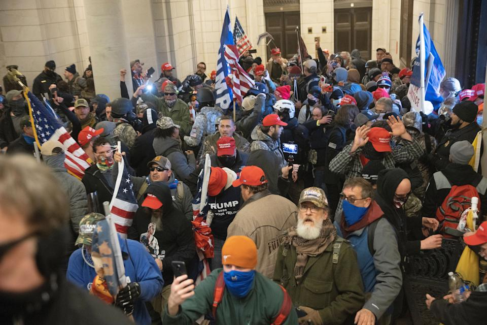 Trump supporters gather near the east front door of the U.S. Capitol after groups breached the building's security on Jan. 6, 2021. (Photo: Win McNamee/Getty Images)