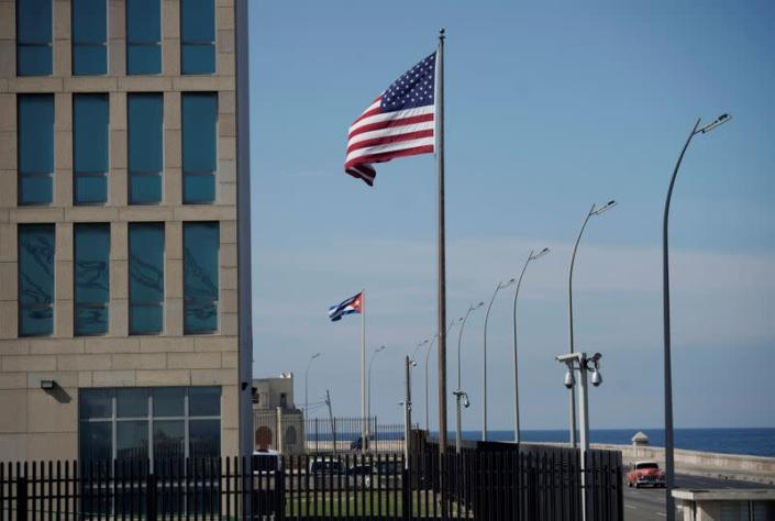 FILE PHOTO: A view of Cuban and American flags beside the U.S. Embassy in Havana
