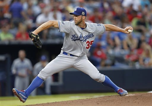 Los Angeles Dodgers starting pitcher Chris Capuano (35) works in the first inning of a baseball game against the Atlanta Braves, Friday, Aug. 17, 2012, in Atlanta. (AP Photo/John Bazemore)