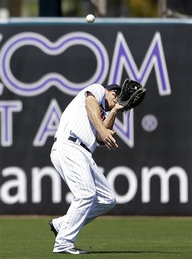 Minnesota Twins center fielder Joe Benson loses the ball in the sun on a hit by Boston Red Sox's Drew Sutton allowing Daniel Nava to score in the second inning of a spring training exhibition baseball game, Thursday, March 7, 2013, in Fort Myers, Fla. (AP Photo/David Goldman)