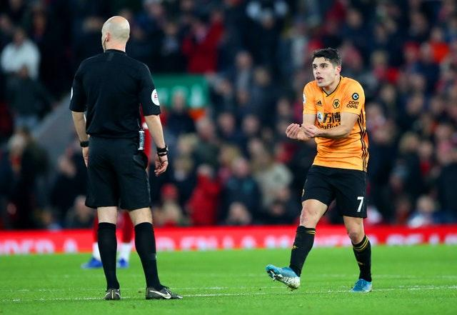 Pedro Neto (right) appeals to referee Anthony Taylor as VAR disallows his goal for Wolves