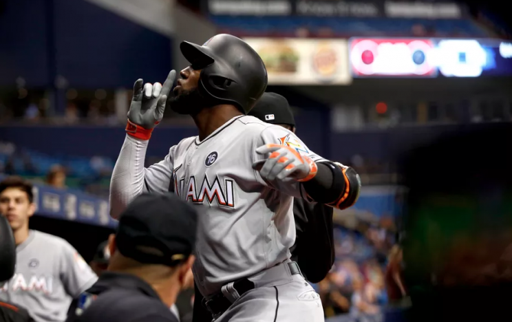 ST. PETERSBURG, FL - MAY 3: Marcell Ozuna #13 of the Miami Marlins celebrates his home run as he makes his way back to the dugout during the fourth inning of a game against the Tampa Bay Rays on May 3, 2017 at Tropicana Field in St. Petersburg, Florida. (Brian Blanco/Getty Images)