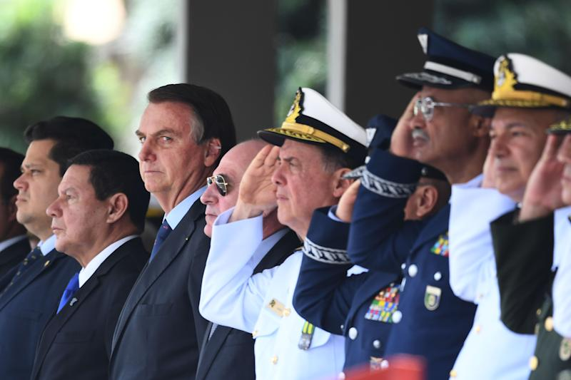 Brazilian President Jair Bolsonaro (3-L) and his vice president Hamilton Mourao (2-L) attend the Navy Day celebrations at Marines Corp headquarters in Brasilia, on December 13, 2019. (Photo by EVARISTO SA / AFP) (Photo by EVARISTO SA/AFP via Getty Images)