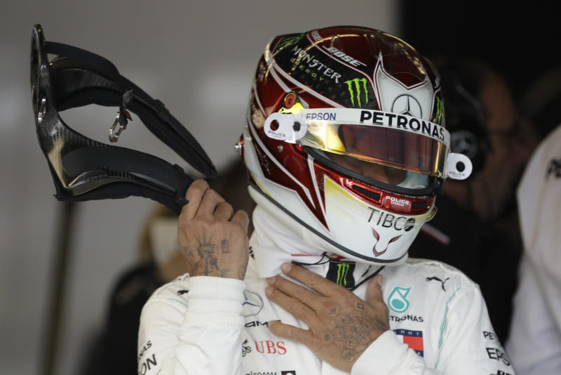 Mercedes driver Lewis Hamilton, of Britain, prepares to drive during the second practice session for the Formula One U.S. Grand Prix auto race at the Circuit of the Americas, Friday, Nov. 1, 2019, in Austin, Texas. (AP Photo/Darron Cummings)