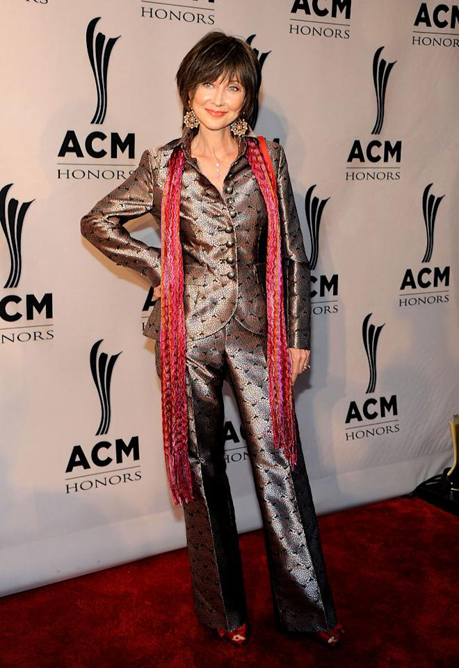 "Country singer Pam Tillis channeled her inner Tin Man by donning this disastrous metallic pantsuit at the 5th Annual ACM Honors in Nashville, Tennessee. Frederick Breedon IV/<a href=""http://www.gettyimages.com/"" target=""new"">GettyImages.com</a> - September 19, 2011"