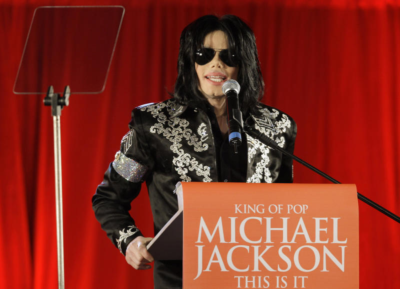 FILE - In this March 5, 2009 file photo, US singer Michael Jackson announces at a press conference that he is set to play ten live concerts at the London O2 Arena in July 2009, in London. A Los Angeles jury reached a verdict Wednesday Oct. 2, 2013, in Katherine Jackson's long-running negligence case against AEG Live LLC, which accuses the concert promoter of being responsible for hiring the doctor convicted of killing her son in 2009. (AP Photo/Joel Ryan, File)