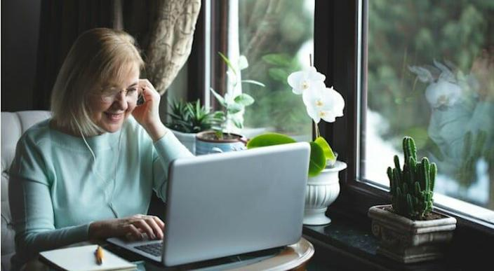 Woman engaged in online investing