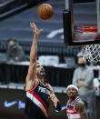 Portland Trail Blazers center Enes Kanter shoots against the Washington Wizards during the second half of an NBA basketball game in Portland, Ore., Saturday, Feb. 20, 2021. (AP Photo/Craig Mitchelldyer)
