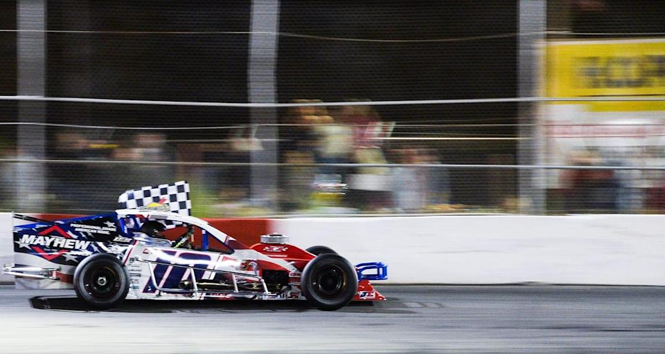 Doug Coby, driver of #10 Mayhew Tools Chevrolet takes a victory lap after winning the Miller Lite 200 for the NASCAR Whelen Modified Tour at Riverhead Raceway in Riverhead, New York on May 15, 2021. (Kathryn Riley/NASCAR)