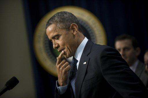 "US President Barack Obama pauses while speaking about the ongoing fiscal cliff negotiations from the White House in Washington on December 31, 2012. US lawmakers missed their deadline to avoid the so-called ""fiscal cliff"" Monday but said they were near to finding a deal to ease the worst impact of the crisis by heading off tax hikes."