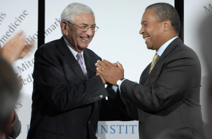 FILE - In this Sept. 4, 2008, file photo, Los Angeles Philanthropist Eli Broad, left, shakes hands with Massachusetts Gov. Deval Patrick, right, at the Broad Institute in Cambridge, Mass., after Broad announced that he and his wife Edythe Broad were donating an additional $400 million to the biomedical institute. Eli Broad, the billionaire philanthropist, contemporary art collector and entrepreneur who co-founded homebuilding pioneer Kaufman and Broad Inc. and launched financial services giant SunAmerica Inc., died Friday, April 30, 2021 in Los Angeles. He was 87. (AP Photo/Josh Reynolds, File)