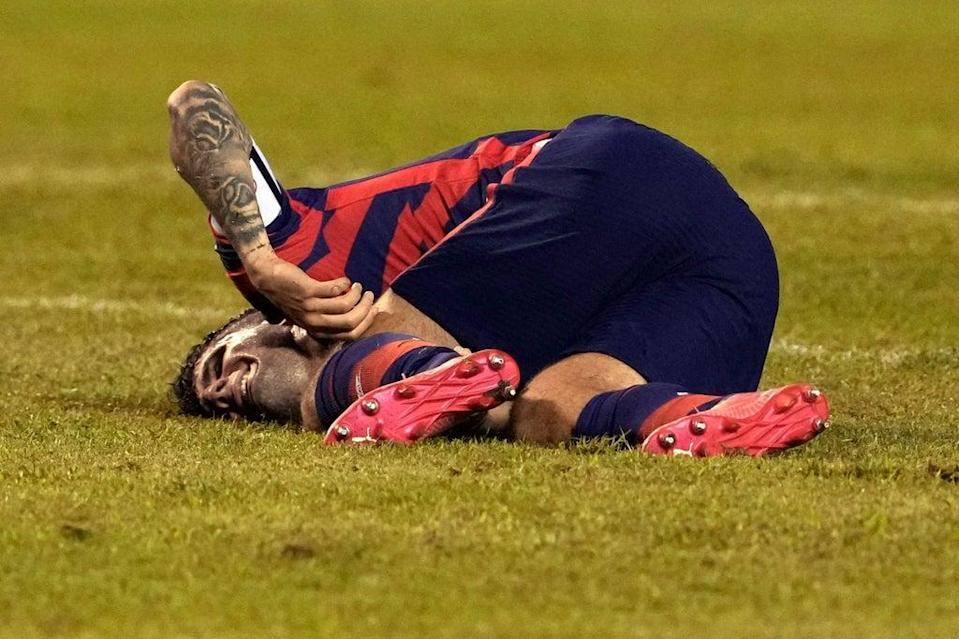 Christian Pulisic was injured during the USA's win over Honduras  (AP)
