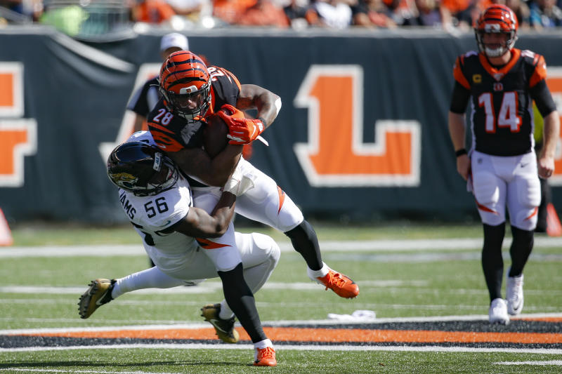 Cincinnati Bengals running back Joe Mixon (28) is tackled by Jacksonville Jaguars linebacker Quincy Williams (56) in the first half of an NFL football game, Sunday, Oct. 20, 2019, in Cincinnati. (AP Photo/Frank Victores)