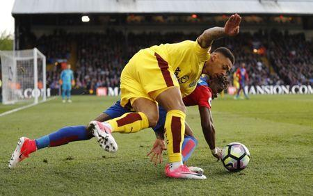 Britain Football Soccer - Crystal Palace v Burnley - Premier League - Selhurst Park - 29/4/17 Burnley's Andre Gray in action with Crystal Palace's Wilfried Zaha Reuters / Stefan Wermuth Livepic