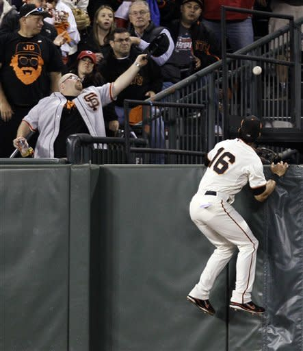 San Francisco Giants center fielder Angel Pagan (16) can't get to the ball after Cincinnati Reds' Ryan Ludwick hit a solo home run in the second inning during Game 2 of the National League division baseball series in San Francisco, Sunday, Oct. 7, 2012. (AP Photo/Eric Risberg)