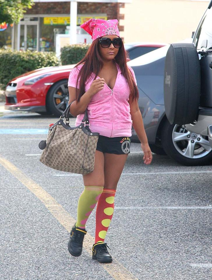 "With the massive raise she recently secured for the third season of ""Jersey Shore,"" we assumed Nicole ""Snooki"" Polizzi would be able to afford some fresh and fashionable new outfits. Guess not. <a href=""http://www.splashnewsonline.com"" target=""new"">Splash News</a> - August 4, 2010"