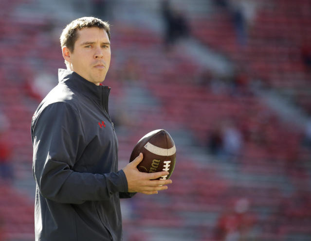 Wisconsin defensive coordinator Jim Leonhard holds a football before an NCAA college football game against Florida Atlantic Saturday, Sept. 9, 2017 in Madison, Wis. (AP Photo/Aaron Gash)
