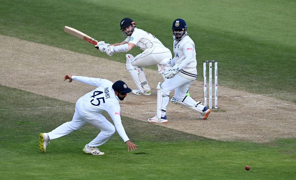 SOUTHAMPTON, ENGLAND - JUNE 23: Kane Williamson of New Zealand hits past Rohit Sharma of India during Day 6 of the ICC World Test Championship Final between India and New Zealand at The Ageas Bowl on June 23, 2021 in Southampton, England. (Photo by Gareth Copley-ICC/ICC via Getty Images)