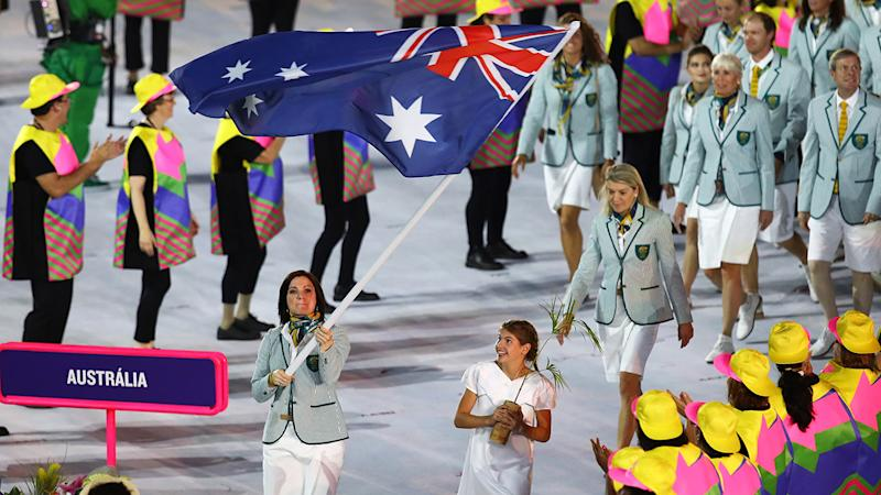 Anna Meares is shown carrying the Australian flag at the opening ceremony for the 2016 Rio Olympics.