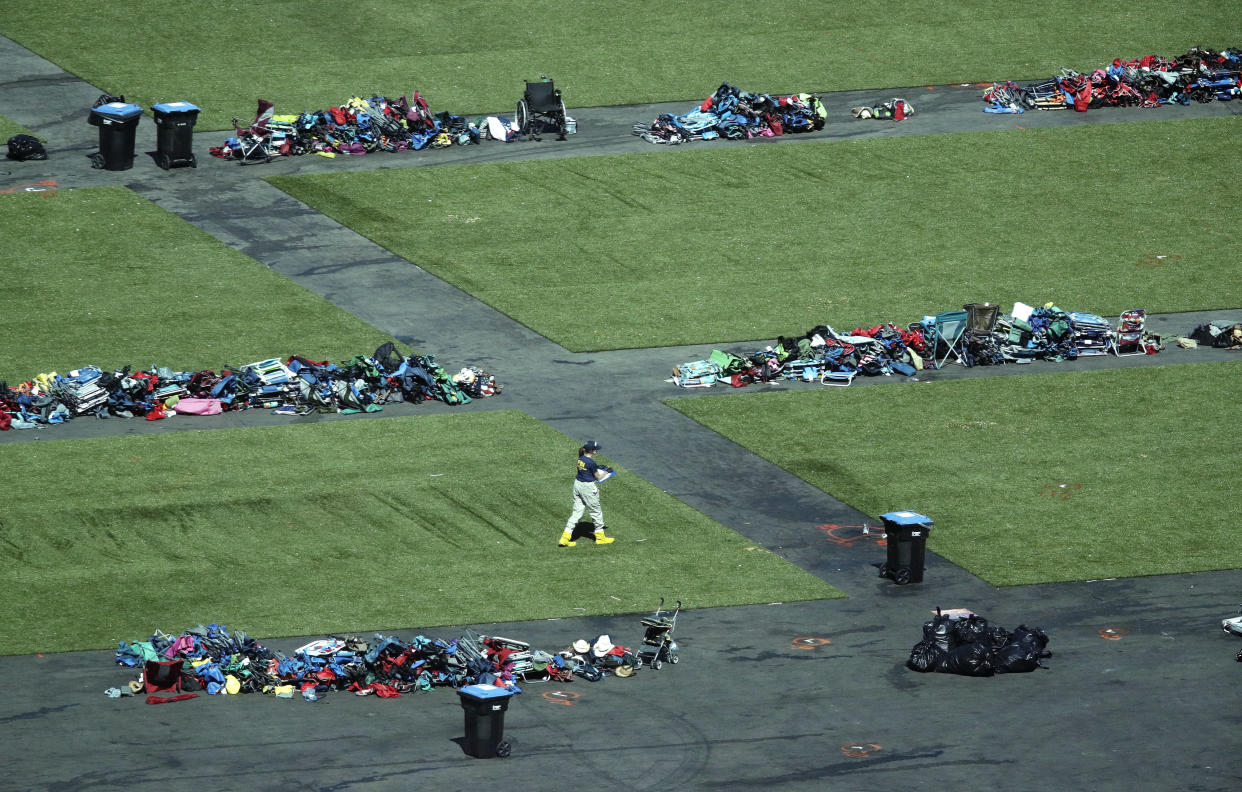 A member of the FBI walks among piles of personal items at the scene of a mass shooting Friday, Oct. 6, 2017, in Las Vegas. (Photo: John Locher/AP)