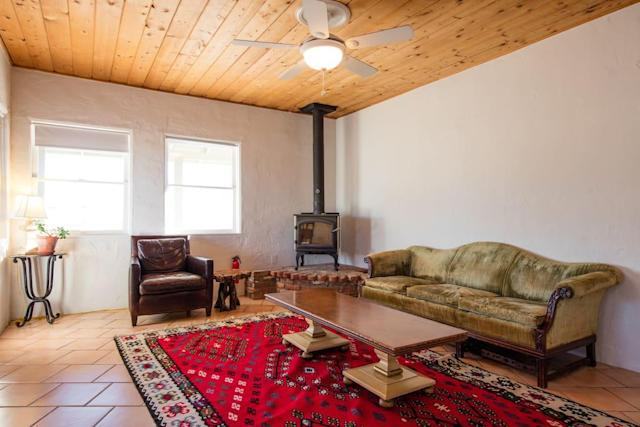 <p>Addmitedly, the interior isn't anything to write home about. That said, it's clean and spacious with ample room to relax.<br>(Airbnb) </p>