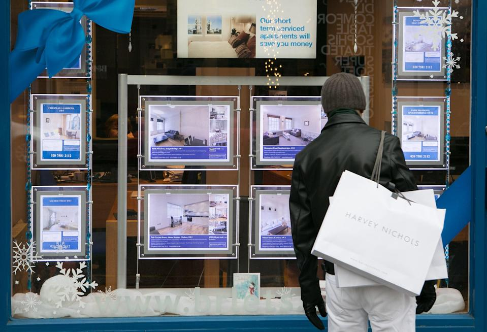 Someone looking in an estate agent's window (PA Archive)