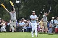 Bryson DeChambeau reacts after teeing off on the ninth hole during the third round of the BMW Championship golf tournament, Saturday, Aug. 28, 2021, at Caves Valley Golf Club in Owings Mills, Md. (AP Photo/Terrance Williams)