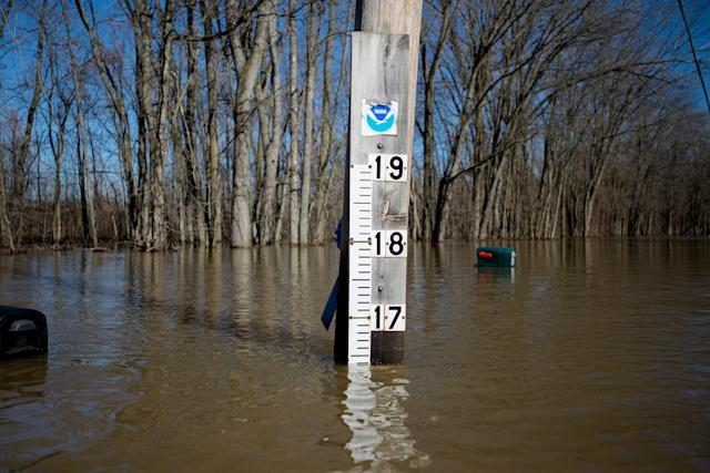 <p>A flood gage stands on Abrigador Trail NE in Comstock Park., Mich., on Monday, Feb. 26, 2018. (Photo: Neil Blake/The Grand Rapids Press via AP) </p>