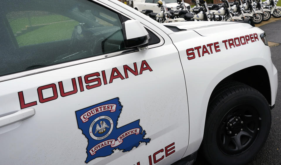 """FILE - This Sept. 25, 2020, file photo, shows a Louisiana State Police vehicle in Louisiana. New court filings show Louisiana State Police troopers joked in a group text about beating a Black man after a high-speed chase last year, saying the beating would give the man """"nightmares for a long time."""" The May 2020 arrest of Antonio Harris bears strong resemblance to the State Police pursuit a year earlier that ended in the still-unexplained death of Ronald Greene. (AP Photo/Rogelio V. Solis, File)"""