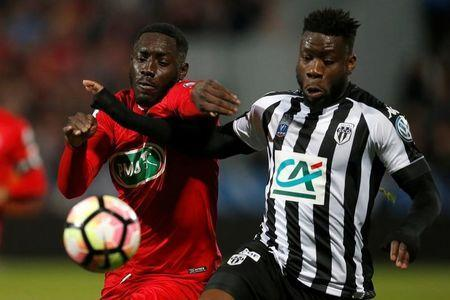 Soccer Football - SCO Angers v EA Guingamp - French Cup Semi-Final - Raymond Kopa Stadium, Angers, France - 25/04/2017. Guingamp's Alexandre Mendy and SCO Angers' Ismael Traore in action. REUTERS/Stephane Mahe -
