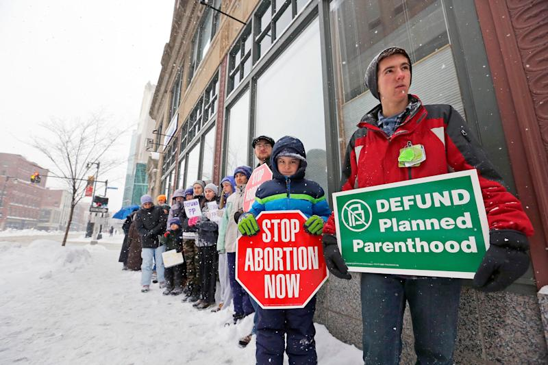 Children protest in the snow outside of Planned Parenthood's Portland, Maine clinic last Februrary.