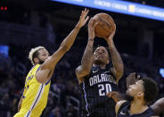 Orlando Magic's Markelle Fultz,center, shoots against Golden State Warriors' Ky Bowman, left, during the first half of an NBA basketball game Saturday, Jan. 18, 2020, in San Francisco. (AP Photo/Ben Margot)