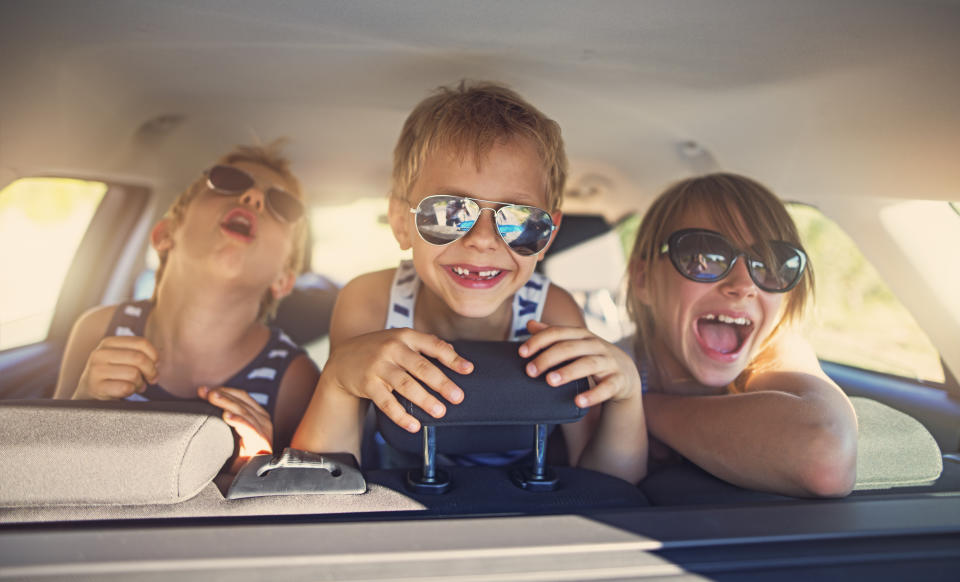 Nothing like a long drive to turn little treasures into little monsters — so be prepared. (Photo: Getty)