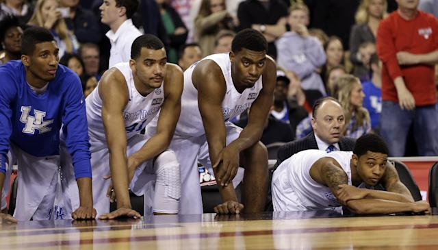 Kentucky players watch from the bench during the second half of the loss to Wisconsin. (AP)