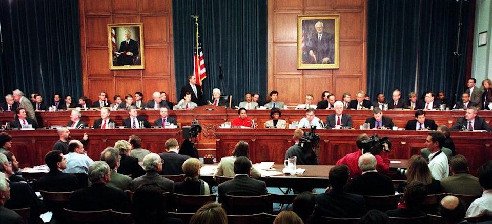 Members of the House Judiciary Committee discuss articles of impeachment against Bill Clinton on 11 December 1998 on Capitol Hill (PAUL J RICHARDS/AFP via Getty Images)