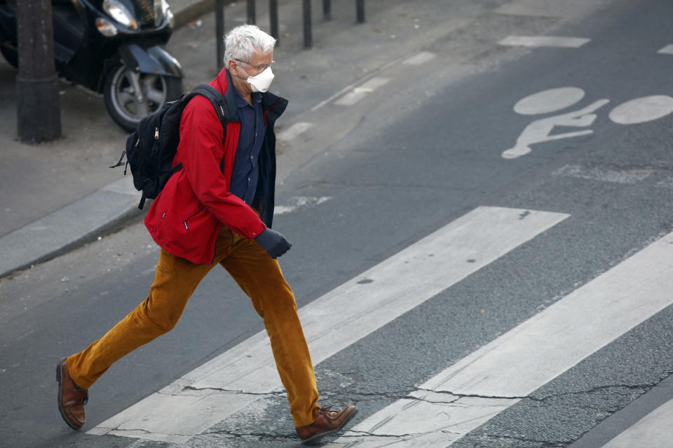A men walks in Paris, on April 8, 2020, during the lockdown in France to attempt to halt the spread of the novel coronavirus COVID-19.   (Photo by Mehdi Taamallah/NurPhoto via Getty Images)