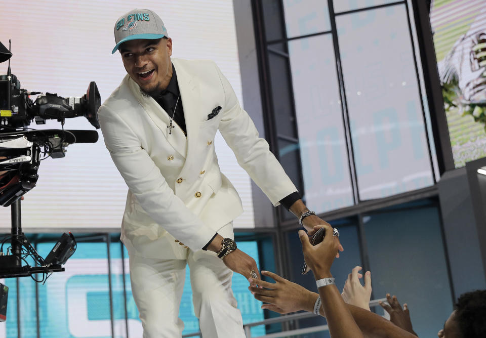 Alabama's Minkah Fitzpatrick walks on stage after being selected by the Miami Dolphins during the first round of the NFL draft. (AP)