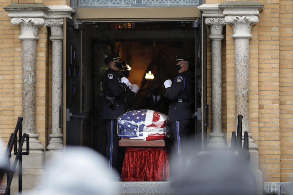 """Capitol Police Officers carry the casket of their fellow officer, the late William """"Billy"""" Evans into St. Stanislaus Kotska Church in Adams, Mass., for his funeral on Thursday, April 15, 2021. Evans was killed this month when a driver struck him and another officer at a barricade outside the Senate. (Stephanie Zollshan/The Berkshire Eagle via AP)"""
