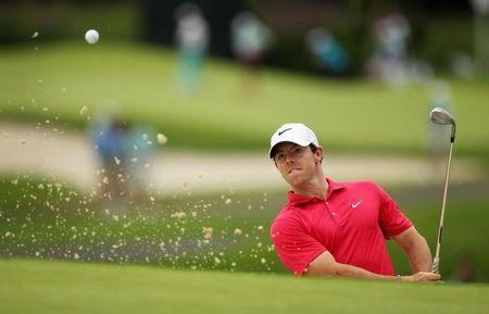 Aug 21, 2014; Paramus, NJ, USA; Rory McIlroy hits out of a greenside bunker on the fifth hole during the first round of The Barclays golf tournament at Ridgewood Country Club. Mandatory Credit: John Munson/THE STAR-LEDGER via USA TODAY Sports - RTR439NG