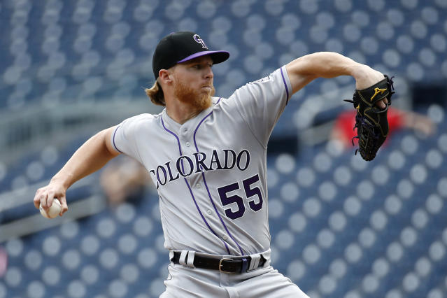 Colorado Rockies starting pitcher Jon Gray throws to the Washington Nationals in the second inning of the first baseball game of a doubleheader, Wednesday, July 24, 2019, in Washington. (AP Photo/Patrick Semansky)