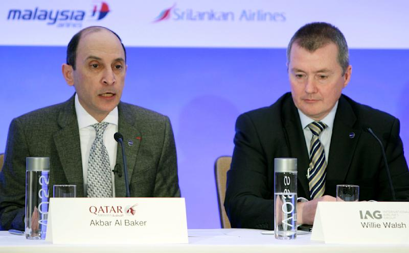 CEO of Qatar Airways Akbar Al Baker, left, speaks during a news conference while International Airlines Group chief executive Willie Walsh looks on in New York, Monday, Oct. 8, 2012. Qatar Airways is joining an alliance of airlines including American Airlines, British Airways and nine other carriers that coordinate routes and allow passengers to earn frequent flier miles on each other's flights. (AP Photo/Seth Wenig)