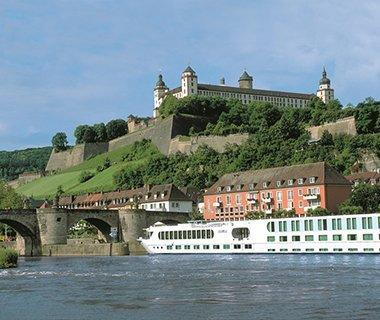 """<p><strong>The Fleet:</strong> 20 classically-designed ships carry passengers through Europe, Asia, Egypt, and more. Uniworld is well-known for their <a href=""""https://www.travelandleisure.com/cruises/river-cruises/european-river-cruises"""" rel=""""nofollow noopener"""" target=""""_blank"""" data-ylk=""""slk:river cruises"""" class=""""link rapid-noclick-resp"""">river cruises</a>. </p> <p><strong>What's Included:</strong> Premium spirits and wines, five-star meals, fitness classes, airport transfers, gratuities, and more. </p> <p><strong>Sample Cruise:</strong> 8-day Enchanting Danube River cruise on the <em>S.S. Maria Theresa</em>. From $2,449 per person.</p> <p><a href=""""http://www.uniworld.com/"""" rel=""""nofollow noopener"""" target=""""_blank"""" data-ylk=""""slk:uniworld.com"""" class=""""link rapid-noclick-resp"""">uniworld.com</a></p>"""
