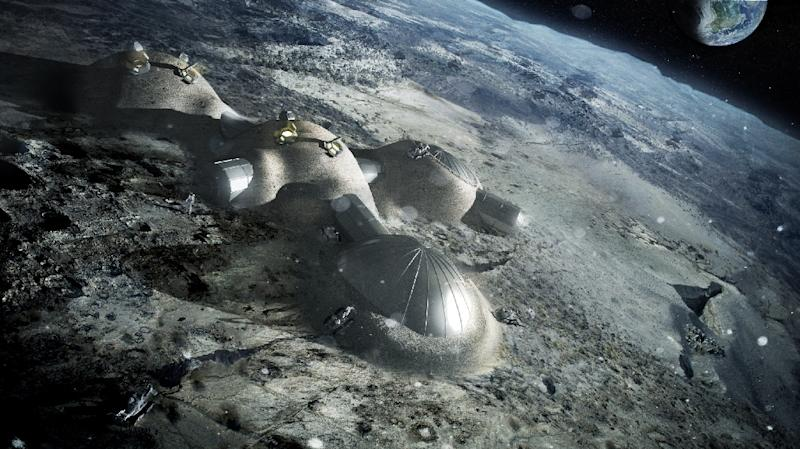 Artist's impression released by the European Space Agency (ESA) on September 22, 2017 shows a multi-dome lunar base being (AFP Photo/BERNARD FOING)